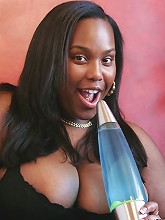 Judy is a steaming hot big black woman. Cum see her getting freaky with a Lava Lamp and showing off those gorgeous big round boobies of hers